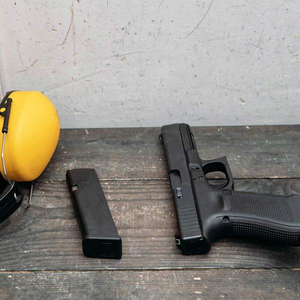 Glock hangun, magazine and hearing protection